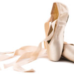 brand new ballet shoes on a white background
