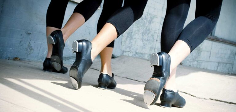 Imag of feet with tap shoes on